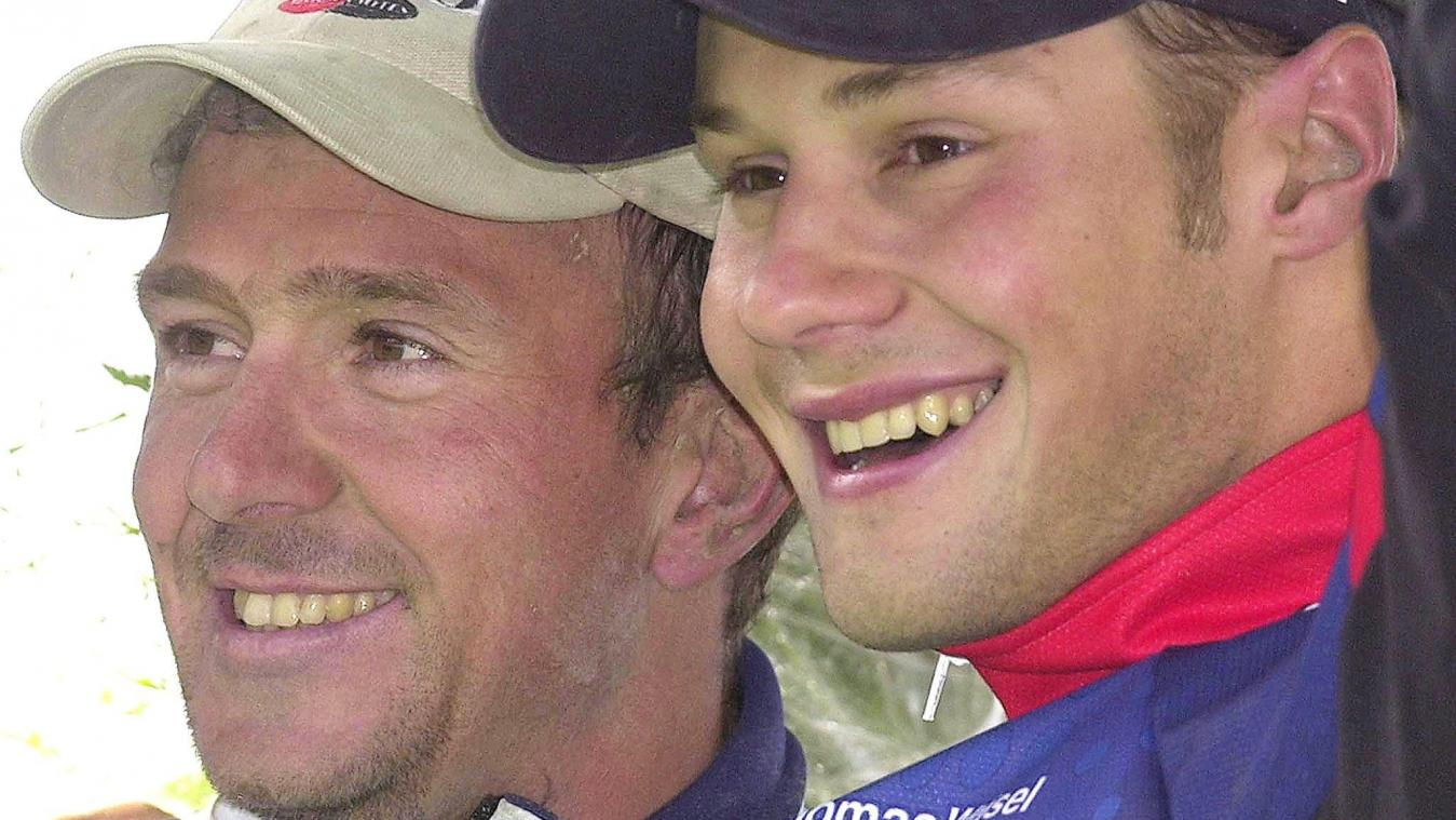 BRU149 - 20020414 - ROUBAIX, FRANCE : Belgian winner Johan Museeuw (L) and and third placed compatriote Tom Boonen celebrate on the podium of the 100th edition of the one-day classic Paris-Roubaix cycling race, Sunday 14 April 2002.   BELGA PHOTO BENOIT DOPPAGNE