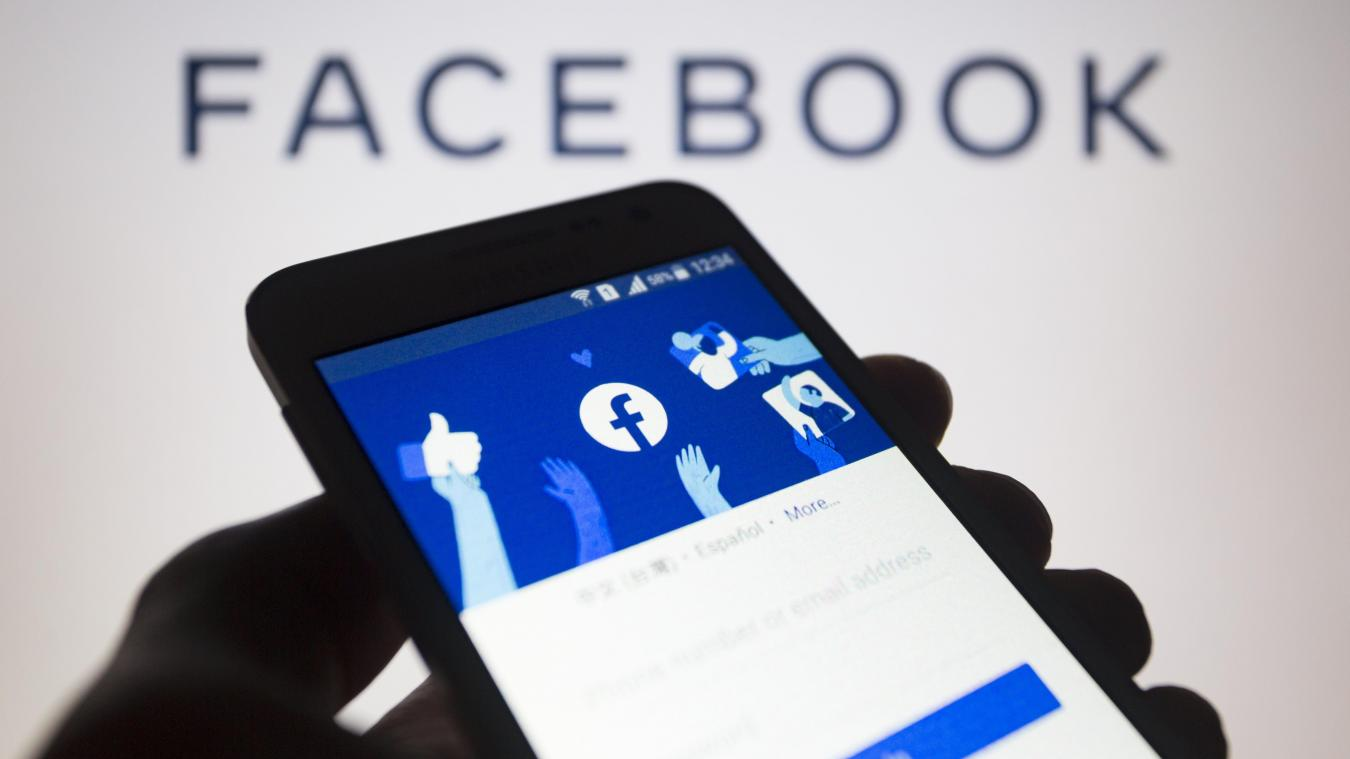 November 13, 2019, Asuncion, Paraguay: Facebook mobile device app displaying its logo on the user account login page, is seen on a smartphone screen against Facebook company wordmark, unfocused on background.