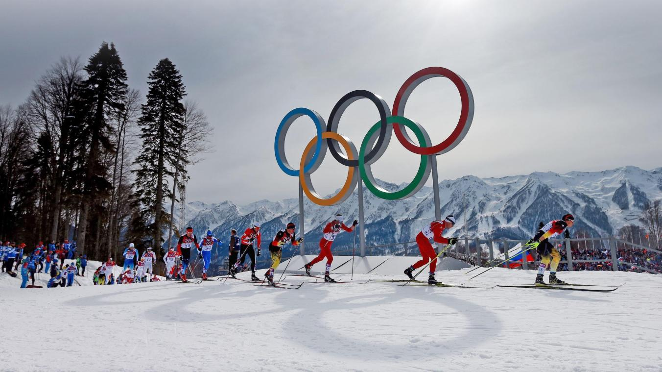 File photo dated 09-02-2014 of Eventual winner Switzerland's Dario Cologna lies second as the field passes the Olympic rings in the Men's 15km + 15km Skiathlon during the 2014 Sochi Olympic Games in Sochi, Russia. ! only BELGIUM !